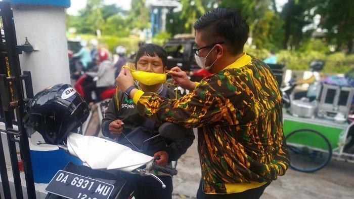 Cegah COVID-19, Felix Gonadi Pimpin AMPG Banjarmasin Bagikan 5 Ribu Masker Untuk Masyarakat